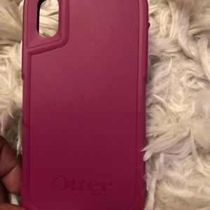 Magenta and black iPhone X Otterbox case.